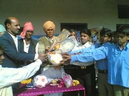 Sports material distribution in school of Somawat village